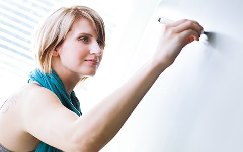 Female Teacher Writing on Whiteboard