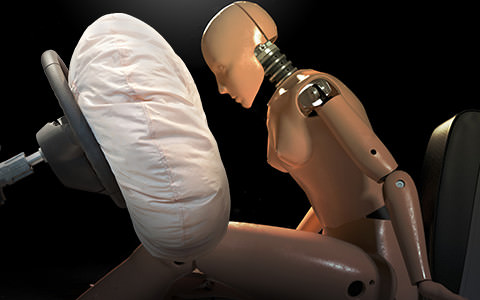 Crash Test Dummy in Car with Air Bag Opened